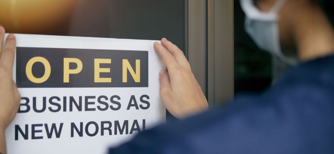 Sign showing a woman getting ready to re-open her business