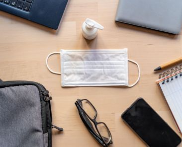 Remote,Work,Kit,On,Wooden,Office,Desk,With,Hand,Sanitizer