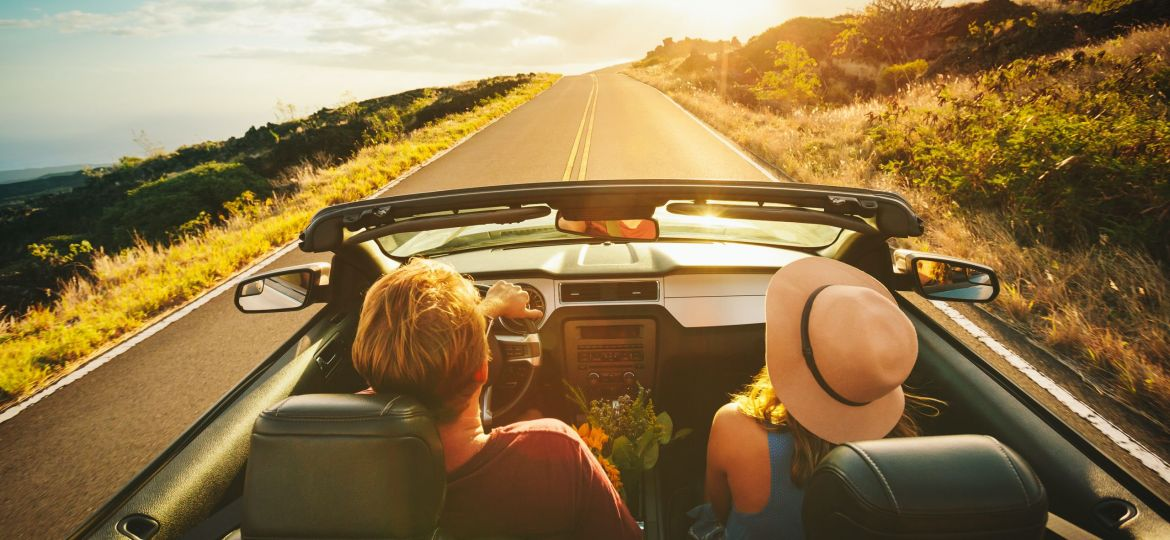 image of young couple on road trip